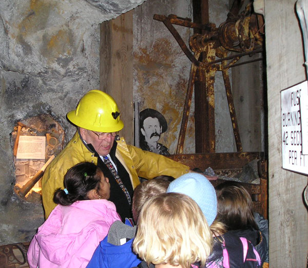 Park City miner Jim Santy explains the hoist during a 2nd grade tour.